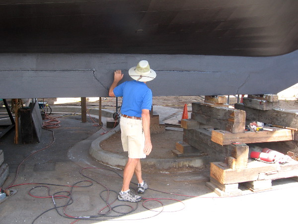Volunteer tour guide shows how six segments of heavy lead are attached to the keel.