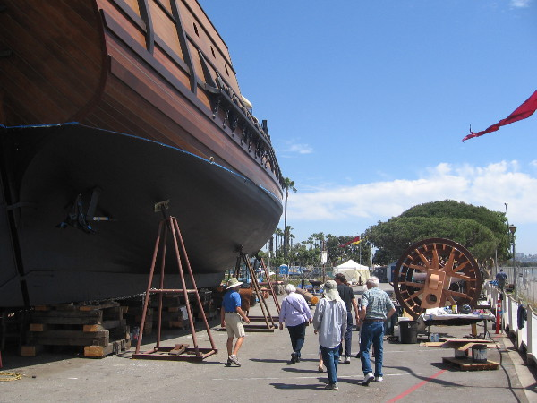 A small tour group investigates the amazing galleon on a sunny San Diego day!