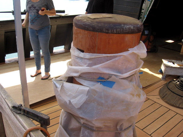 Capstan is a vertical timber that projects through the deck. Bars will be inserted and used by sailors to turn the capstan, hauling ropes or chains.