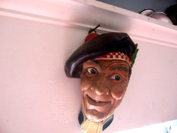 This merry fellow was looking down at cottage visitors from a spot near the ceiling.