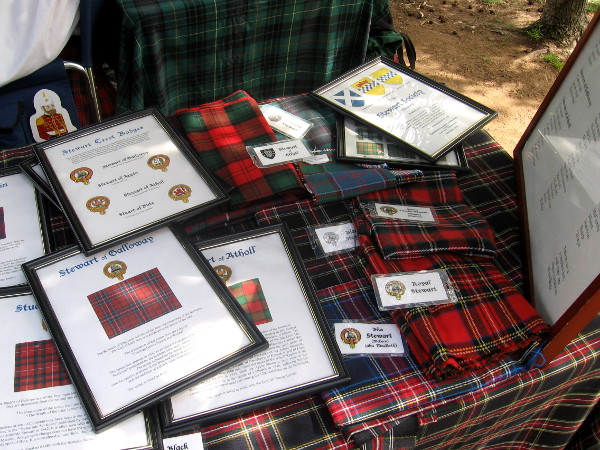Exhibit on one outdoor table helped identify many differently patterned tartans.