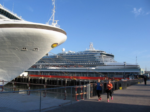 Two luxurious Grand-class cruise ships gleam on either side of the Cruise Ship Terminal.