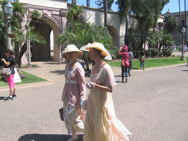 Folks in old-fashioned dresses and nostalgic garb were walking up and down El Prado.