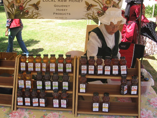 This nice lady in a bonnet was selling honey produced in San Diego.