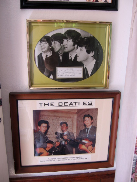 Beatles display on a wall inside the House of England cottage.