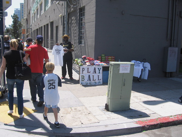 This smiling entrepreneur set up shop on a sidewalk a couple blocks from Petco Park.