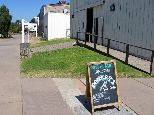 Walking through Old Town San Diego State Historic Park we see a sign near Seeley Stable Museum. Let's go see the donkeys!
