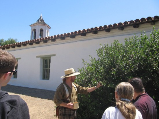 Tour guide shows native Lemonade Berry near Casa de Estudillo in Old Town.