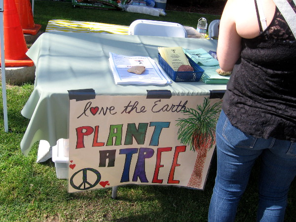 One many signs with environmental messages... love the Earth. Plant a tree.