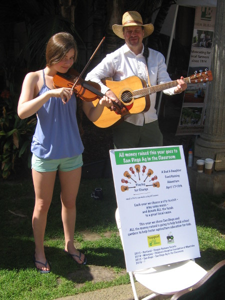 This smiling Dad and daughter musical duo was raising money to help build school gardens.