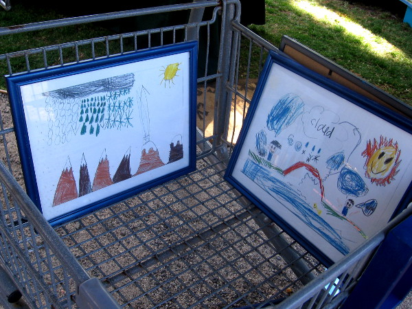 Kids' art shown at The Project Lennon table. The organization promotes peace and positive outlets for urban youth.