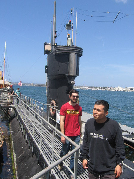 Walking along the deck to forward end of the submarine. The tower-like sail contains the bridge, periscope and communications masts.