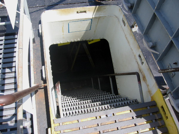 This forward hatch (and the rear one) were cut into the hull so museum visitors could easily walk through the sub's length. Originally there was one hatch, at the sail.