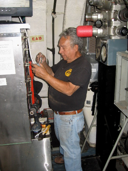 An electrician volunteer, Ed, at work just inside the USS Dolphin. He told me several stories from his days serving on submarines.