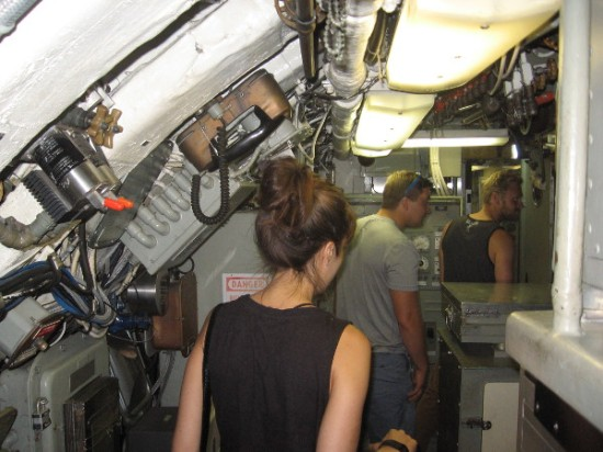A group of visitors is entering the amazing Control Room, near the center of the USS Dolphin.