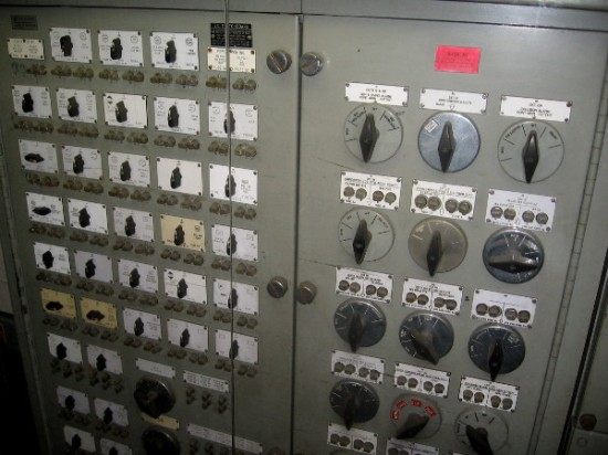 A panel with many complicated switches. In the Control Room, one can monitor the main storage batteries, generators and propulsion system.