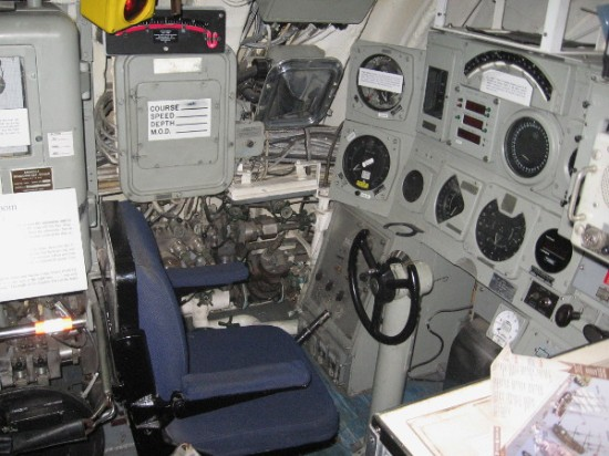 The wheel used to pilot the Dolphin. One drove using only instruments, including gauges that display rise/dive, ordered depth, system depth, cavitation, turns, dummy log, depth to keel.