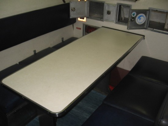 This dining table was constantly in use. Not much to see in the way of decor.