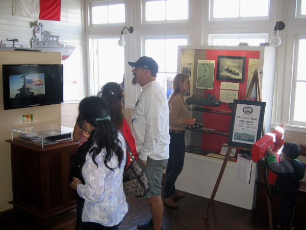 Inside the museum's steam ferry Berkeley, visitors check out informative exhibits as they wait to board the Swift Boat.