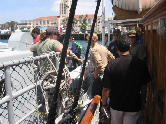 People board the Vietnam-era boat from the Maritime Museum's docked steam yacht Medea.