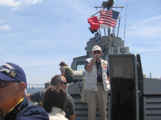 A museum volunteer narrates our tour and points out some of the unique sights on San Diego Bay.