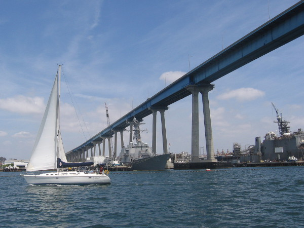 We pass a sailboat and begin under the Coronado Bay Bridge. We are approaching San Diego's very large, busy shipyards.