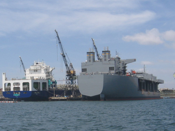 The gigantic gray ship is the USNS Lewis B. Puller. The first of its kind, it's a forward staging base that will act as a floating base or transfer station.