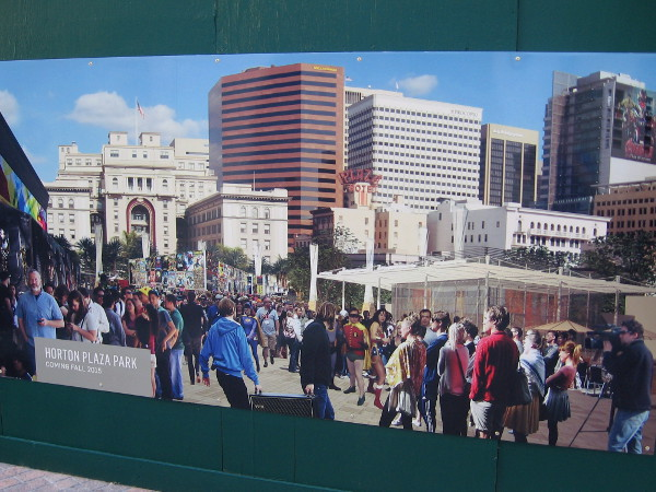 Conceptual artwork on the construction site fence. This image shows a San Diego Comic-Con event taking place downtown at the future Horton Plaza Park.