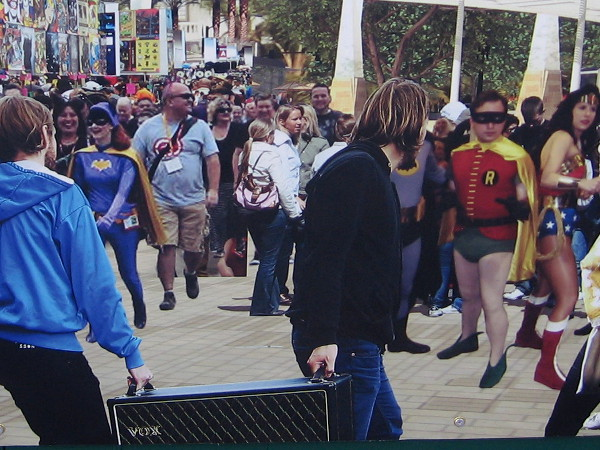 Zooming in, I spot several superheroes!