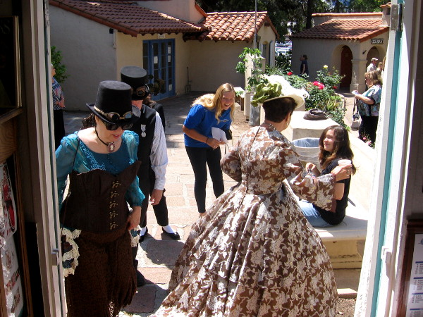 A bustle of Victorian activity in front of the House of England cottage.