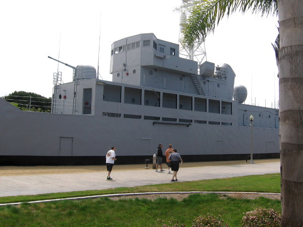 People walk past the newly painted USS Recruit near Liberty Station.