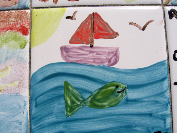 That big green fish is longer than that sailboat!