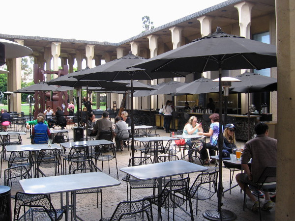 Diners enjoy Panama 66 food and refreshment in the cool Sculpture Court of the San Diego Museum of Art.