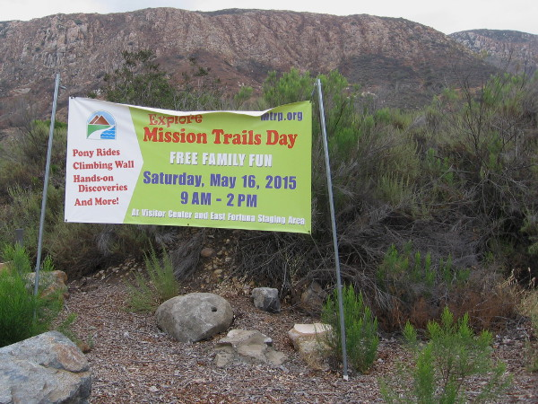Banner beside Father Junipero Serra Trail announces Explore Mission Trails Day!