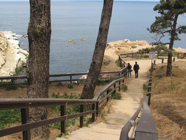 Wooden steps plunge down to a scenic view point atop amazing sandstone cliffs. In the narrow cove on the left is an entrance to a sea cave.