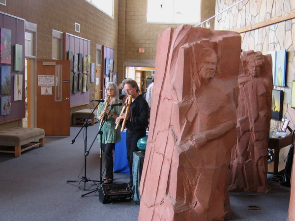 Flutists play near Heritage sculpture depicting Kumeyaay elders. Amazing monumental artwork is by T.J. Dixon and James Nelson.
