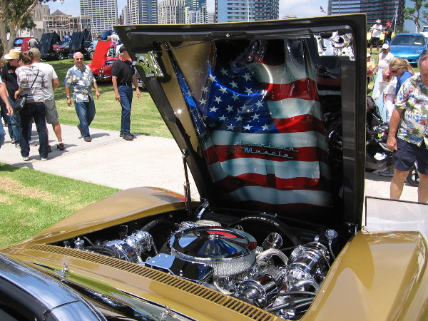 Shiny metallic American flag inside the hood of a cool Chevy Corvette.