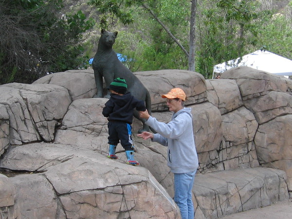 Family checks out a very cool sculpture of a mountain lion at the amphitheater. This secretive animal is rarely seen around here.