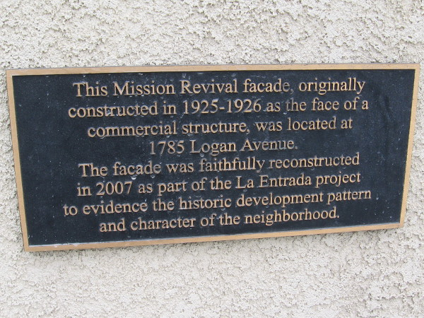 Plaque on La Entrada project explains reconstructed Mission Revival facade.