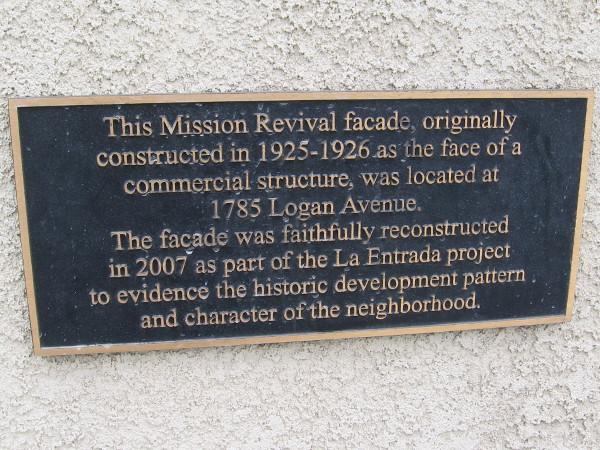Plaque on La Entrada project explains reconstructed Mission Revival facade.
