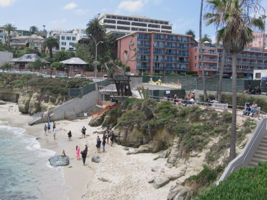 Looking down at La Jolla Cove Beach from the north. Buildings along Coast Boulevard are surmounted by those on Prospect Street.