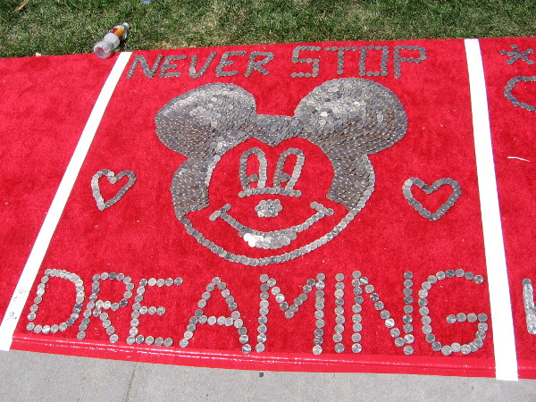 Never Stop Dreaming. It's the face of Mickey Mouse made of quarters!