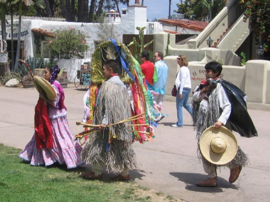 Performers in the Cinco de Mayo weekend Folklorico Competition walk toward the Fiesta de Reyes stage area.