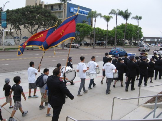 Drums, banners, uniforms and kids stepping proudly down the San Diego sidewalk.