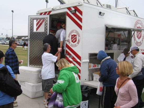 Coffee is served from rear of an emergency disaster services vehicle.