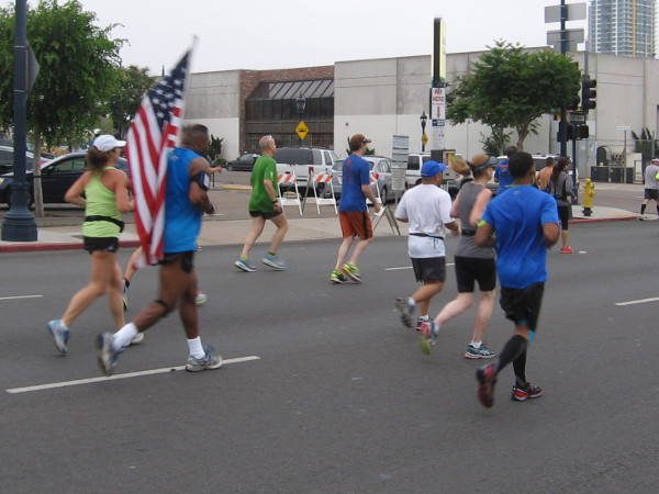 Many flags, signs and costumes were seen all along the race course.