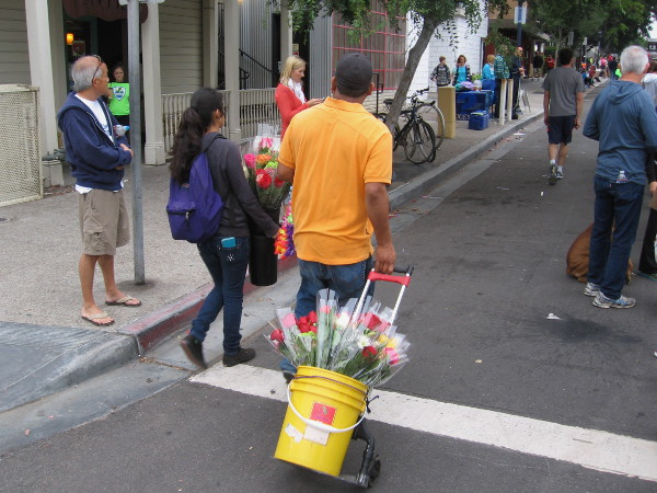 Meanwhile, flowers are being sold to onlookers beside the race route.