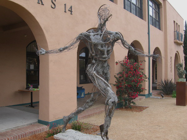 Runner by Robert Michael Jones with strange muscle, bone and energy. Three pieces by this artist stand in front of NTC Liberty Station's Barracks 14.