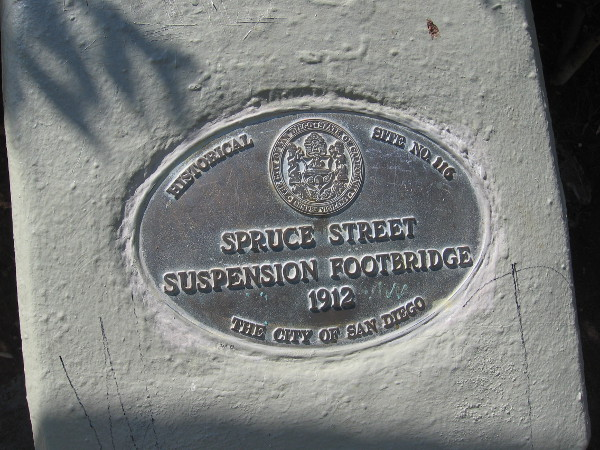 The Spruce Street steel cable suspension footbridge, engineered by Edwin Capps, was erected in 1912.