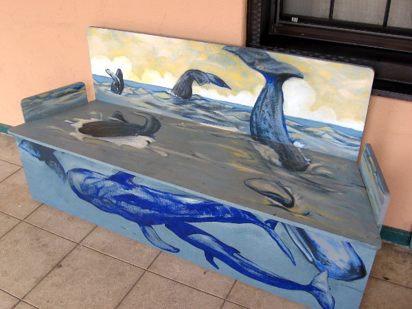 Cool scene of breaching whales decorates this bench found on the North Promenade.